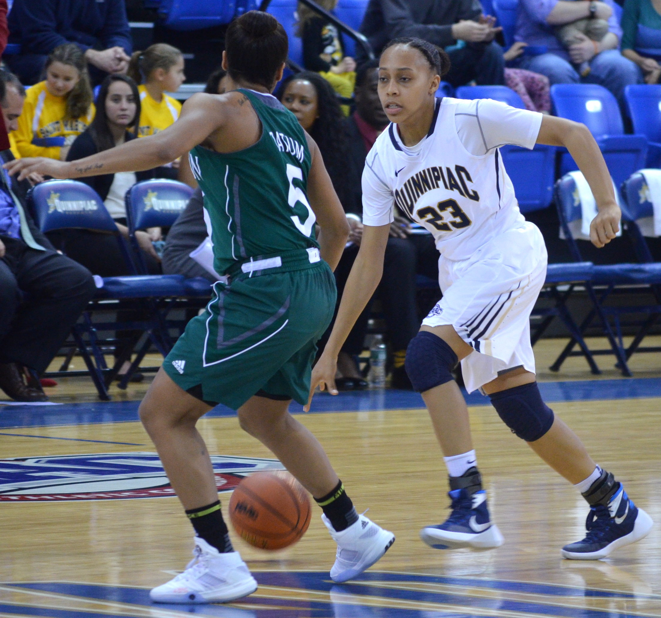 Jordan Novack|Quinnipiac Chronicle Jasmine Martin drives towards the net vs Manhattan 12/6/15