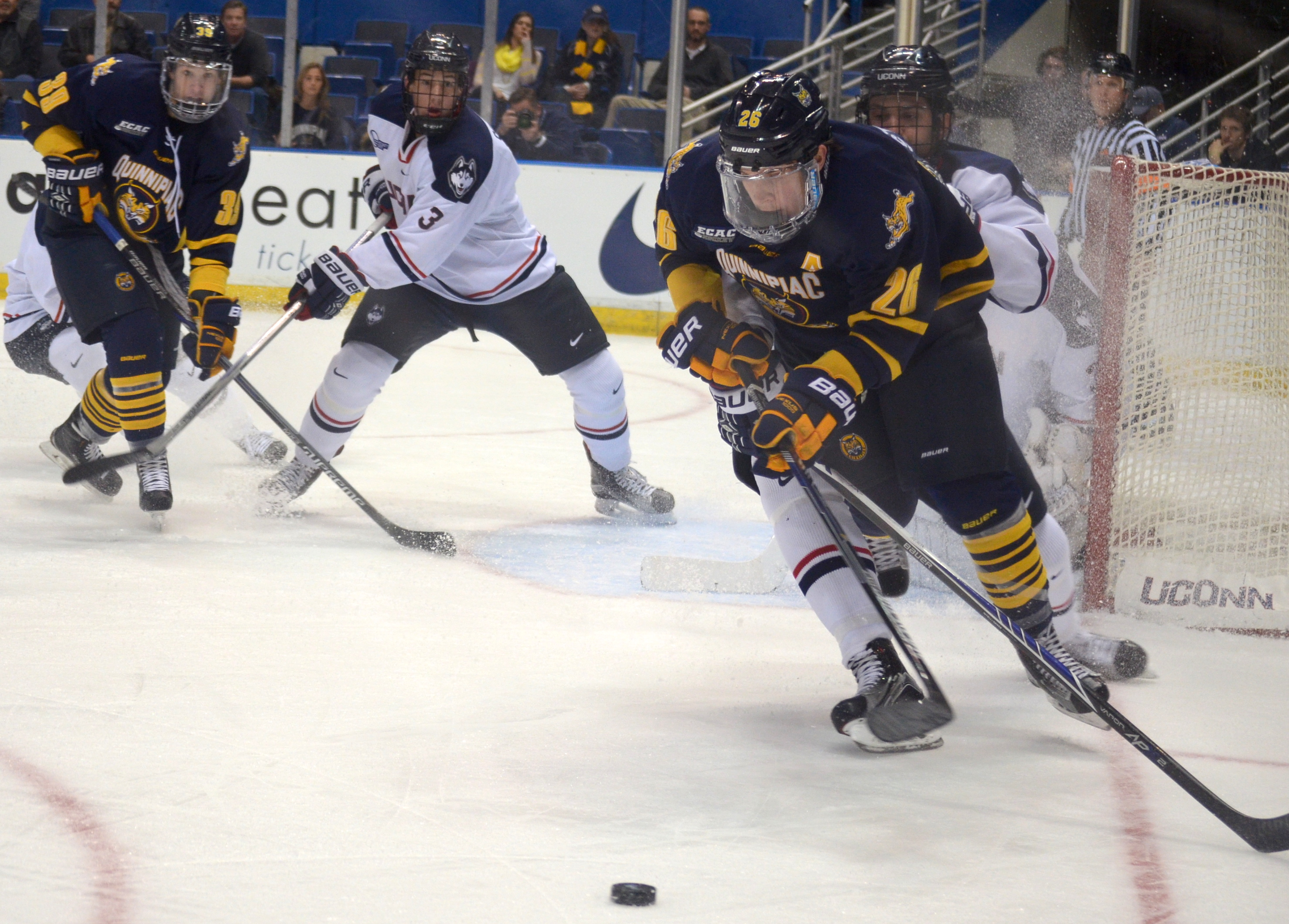 Jordan Novack|Quinnipiac Chronicle Travis St. Dennis carries the puck away from the net vs UConn 11/17/15