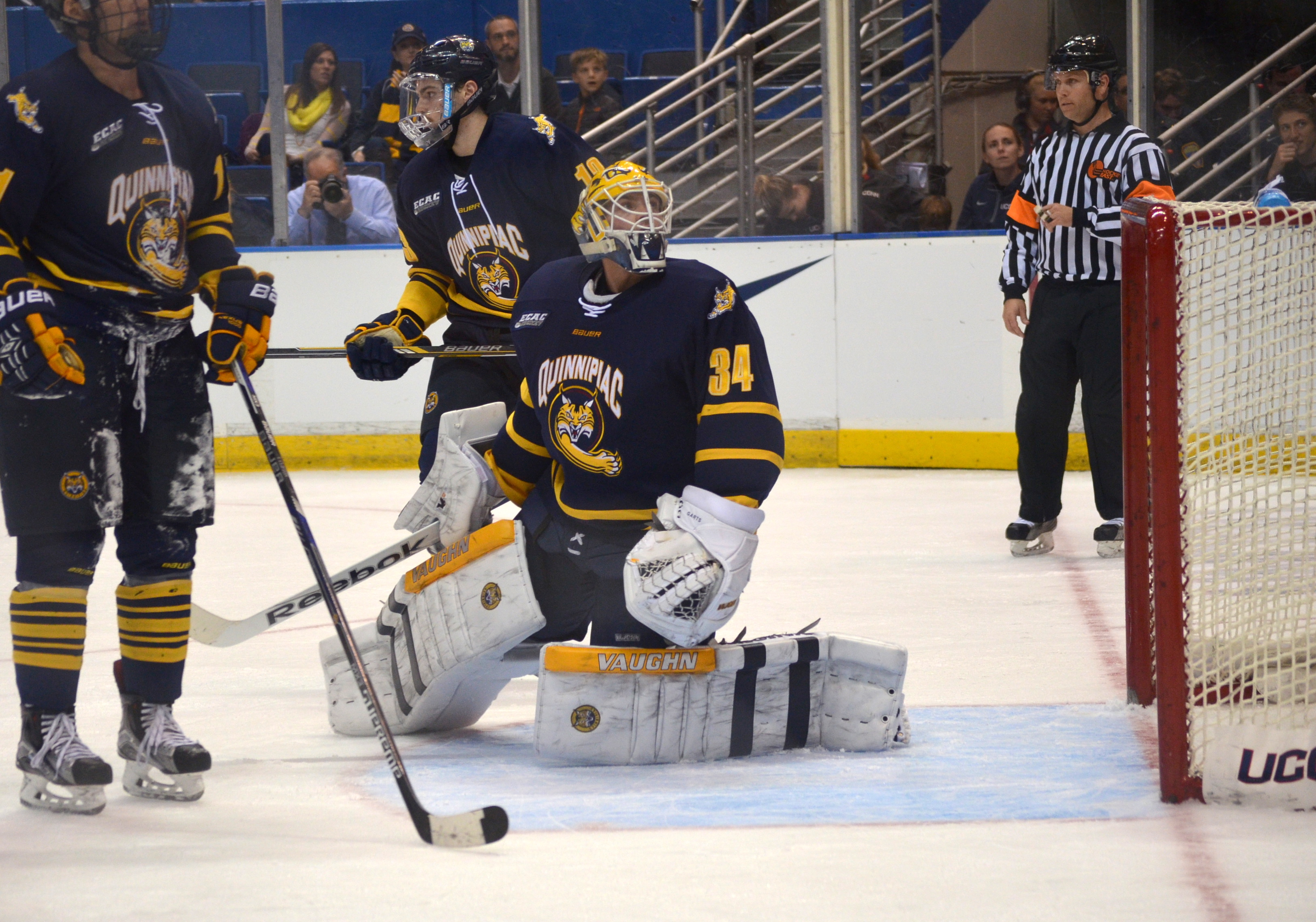 Jordan Novack|Quinnipiac Chronicle  Michael Garteig watches a shot he deflected fly over head vs UConn 11/17/15