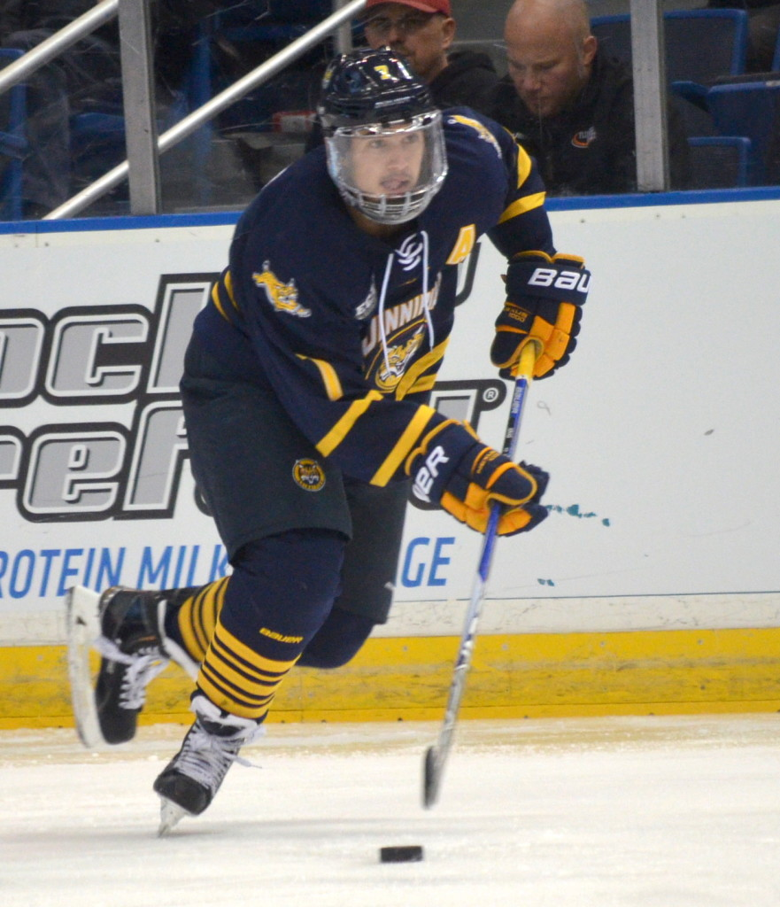 Jordan Novack|Quinnipiac Chronicle Sam Anas looks to move the puck vs UConn 11/17/15