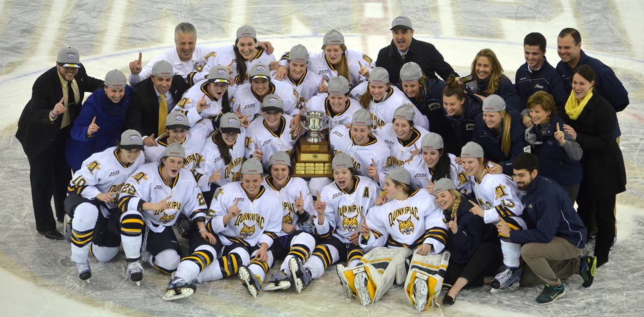 Nick Solari|Quinnipiac Chronicle The women's ice hockey team poses with their ECAC championship trophy following the game